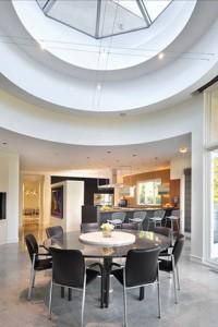 Dine-under-a-skylight.-Photo-via-Baird-and-Warner-John-S.-Eckert-Photography